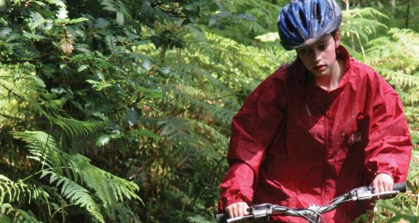 Person on a bike in a wooded area