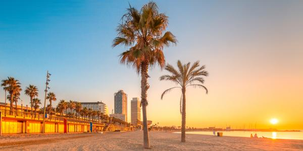 Sunsetting in the background of a beach front in Barcelona, Spain.