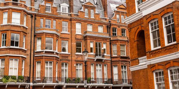 Facade of opulent British Victorian Edwardian terraced flat in red bricks in Chelsea, London.
