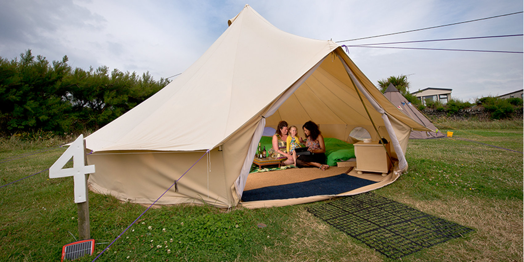 Family enjoying their bell tent at YHA